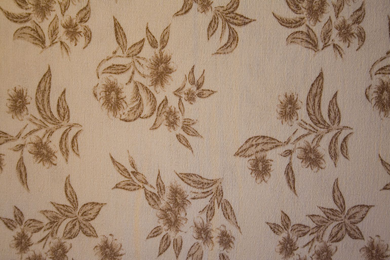 Textile texture with yellow flower patterns