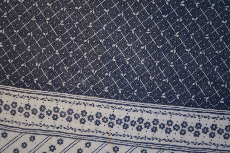 Blue textile texture with patterns – closeup