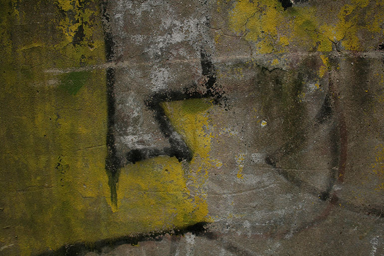 Concrete with dirty yellow paint