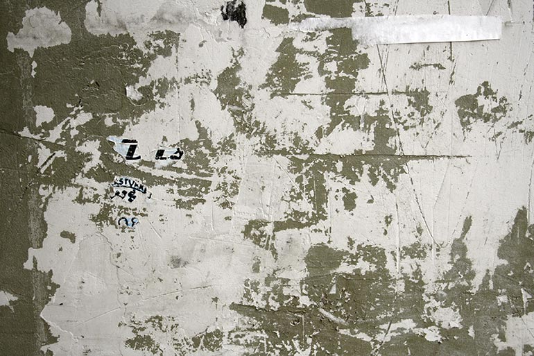 Grunge, white painted cracked wall texture