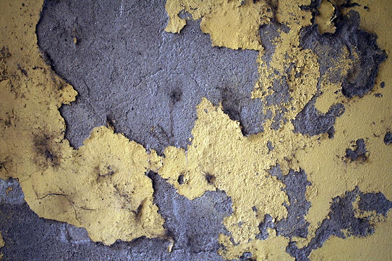 Yellow and grey cracked wall texture
