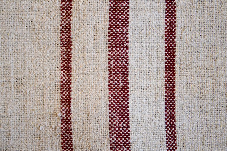White textile texture with red lines