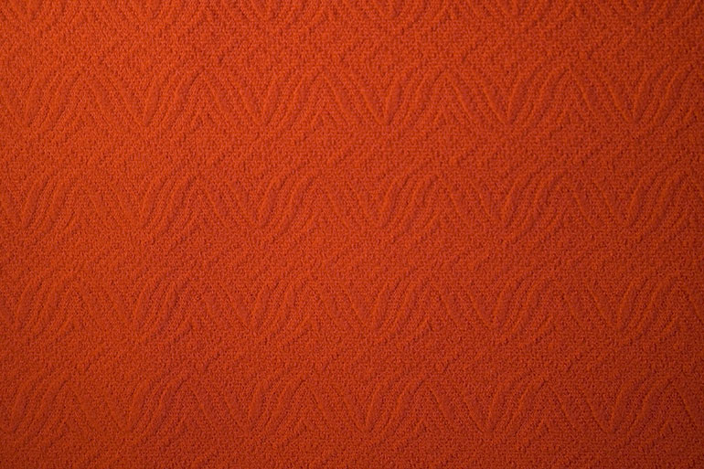 Orange textile texture with patterns