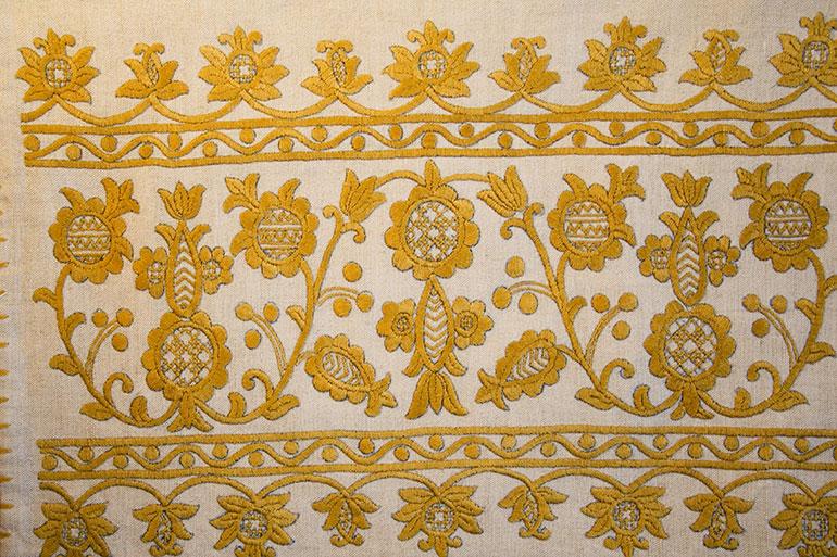 Yellow patterns on white textile texture