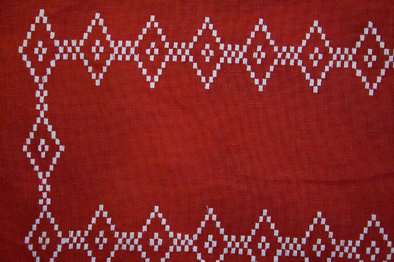 Red textile texture with white square patterns