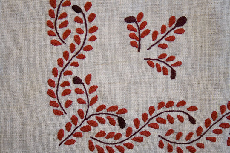 Red flower pattern in linen texture
