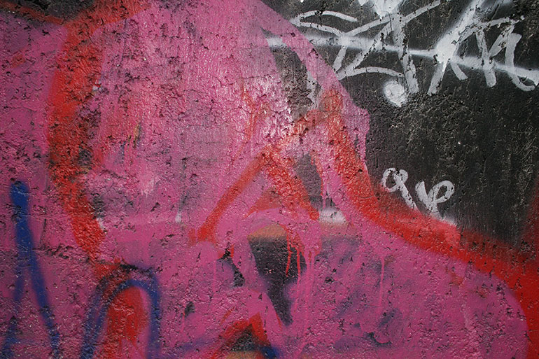 Pink painted graffiti texture for grunge design