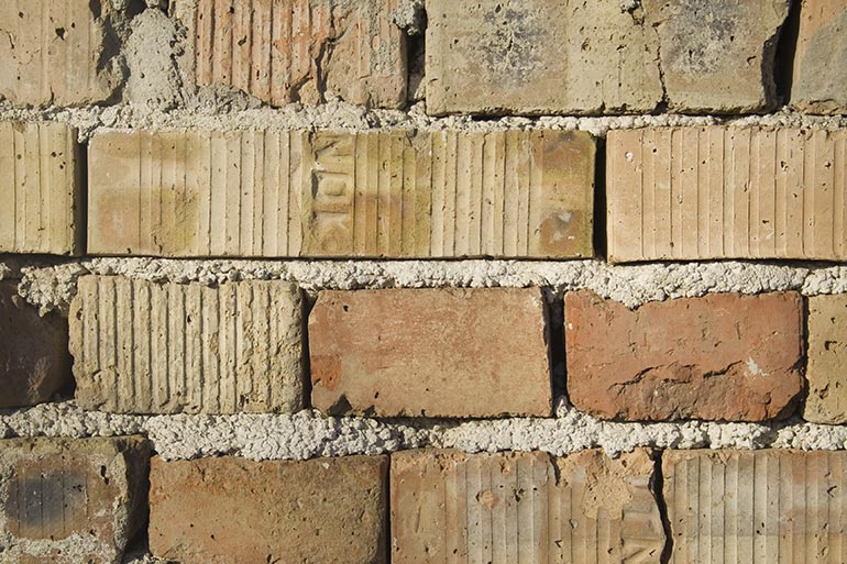 Brick wall with concrete texture