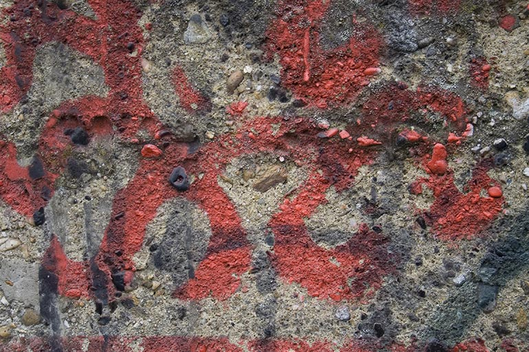 Concrete, painted red stock texture