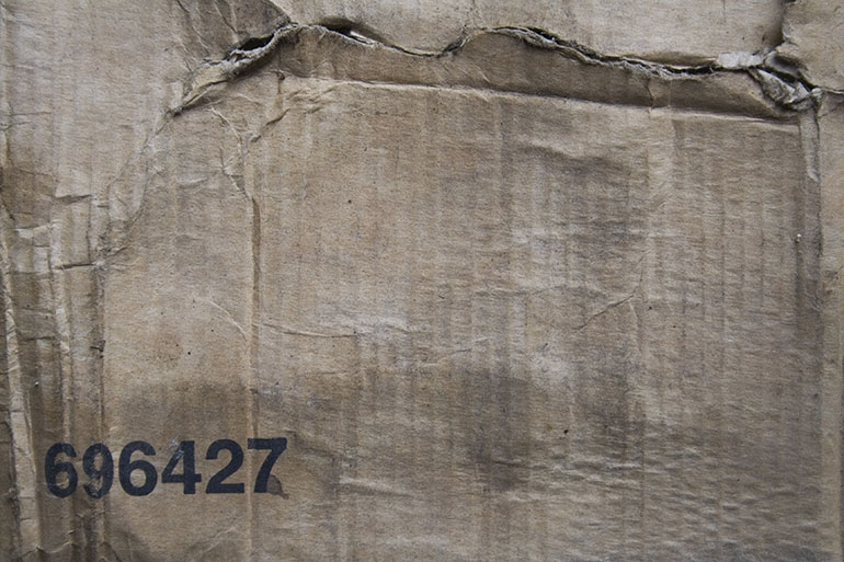 Cardboard box texture with typo