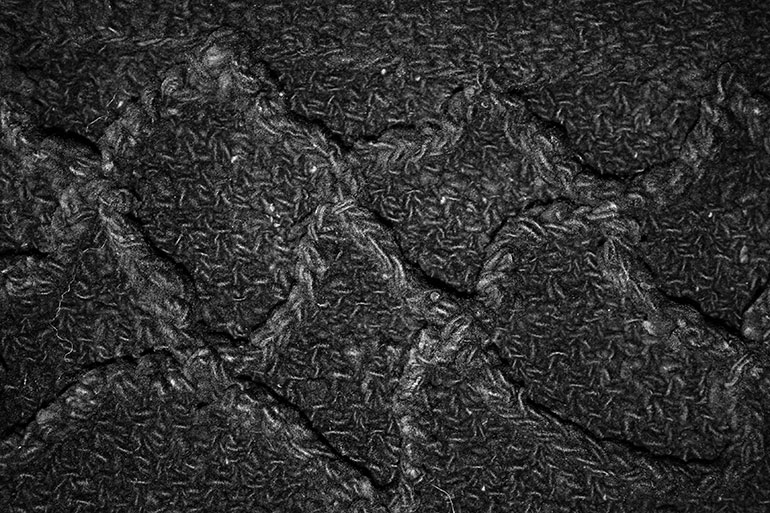 Black textile texture with patterns
