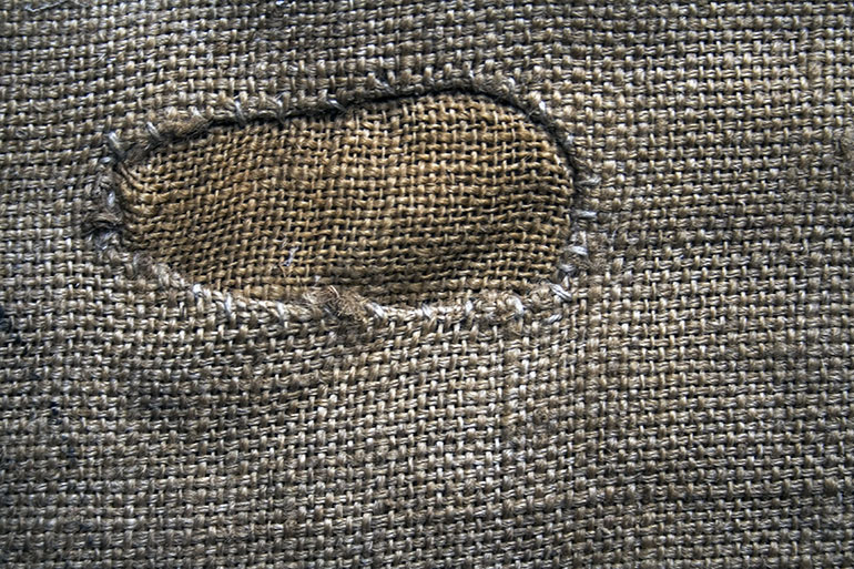 Woven fabric with oval sewing texture