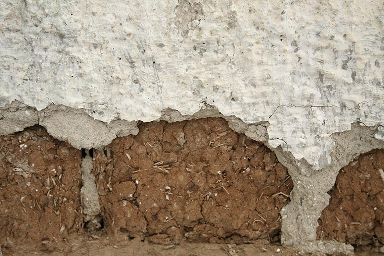 Old cracked wall with white plaster