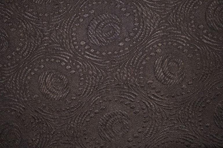 Black textile texture with circle nonfigurative patterns