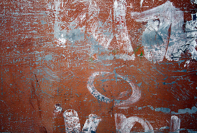 Grunge texture with cracked blue paint