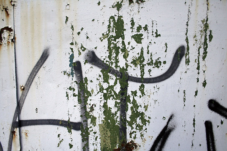 painted-wall-with-green-cracked-paint-medium