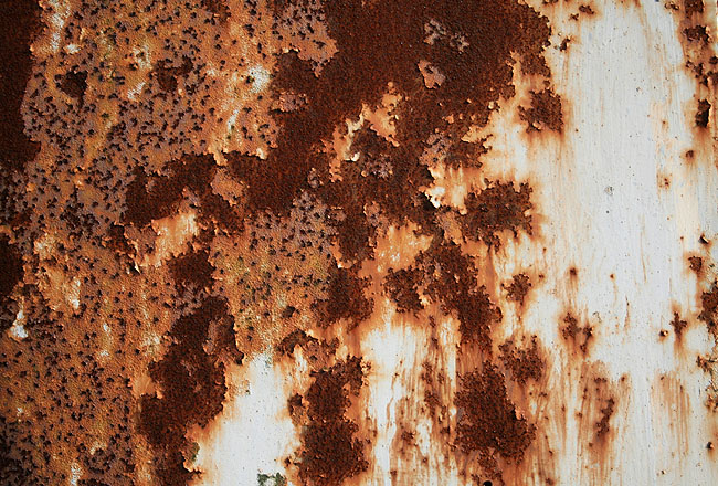 Rusty metal texture with some white