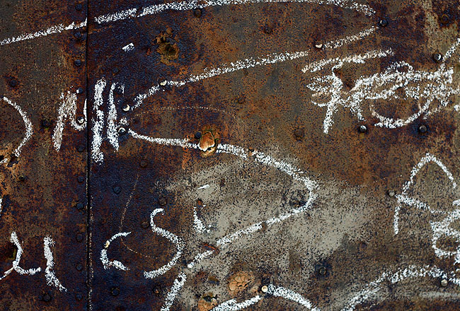 Rusty iron close-up with doodle