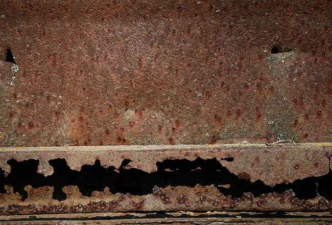 Rusty metal with cracks