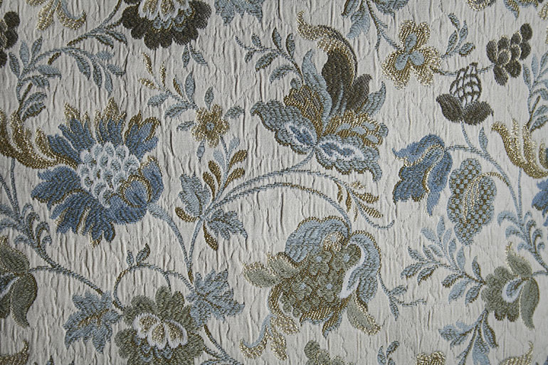Blue flowers on fabric texture