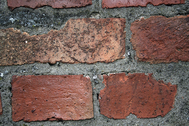 Old brick wall texture with grey concrete